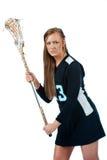 MädchenLacrosse getrennt auf weißem Hintergrund Stockfotos