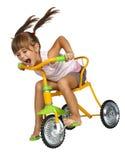 Mädchenlaufwerk fasten Fahrrad Lizenzfreies Stockfoto