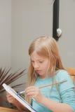 Mädchenmalerei Lizenzfreie Stockfotos