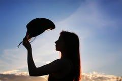 Mädchenschattenbildcowboy Stockfoto
