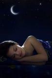 Mädchenschlafen Stockfoto