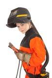 Mädchenschweißerarbeitskraft in der Schweißensschablone Stockbild