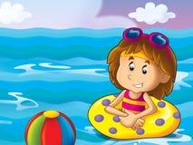 Mädchenschwimmen im Wasser Stockbild