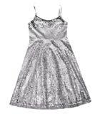 Mädchensilberkleid lokalisiert Funkelndes Partykleid Stockfotografie