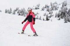 Mädchenskifahrer Stockfoto