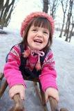 Mädchenspaß auf dem Schnee Lizenzfreies Stockfoto