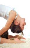 Mädchenturner auf einem weißen Hintergrund stockfoto