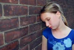 Mädchenumkippen Stockfoto