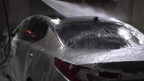Mädchenwäschen ein Auto stock footage