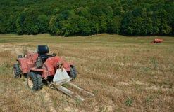 Mähdrescher und Traktor Stockfotos