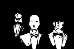 Män modellerar i svart frack på ställa ut på svart Royaltyfria Bilder