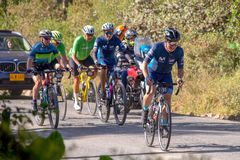 Men and women of all ages ride bicycles during the development of the Gran Fondo Nairo Quintana