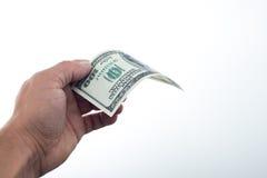 Män sade 10000 dollar i hand Arkivfoton
