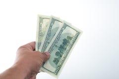 Män sade 10000 dollar i hand Royaltyfria Bilder