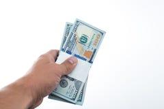 Män sade 10000 dollar i hand Royaltyfria Foton