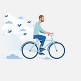 Män som rider en cykel Royaltyfri Foto
