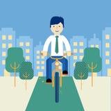 Män som rider en cykel Royaltyfri Bild