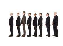 Männer in der Zeile Stockfotos