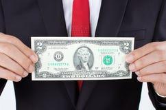 Männer, die Geld anhalten Stockfotos