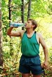 Männer, die nach Lack-Läufer stillstehen Lizenzfreie Stockfotos