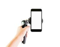 Männer halten Ausrüstung, um Telefon herzustellen, um Erschütterung zu verringern Machen Sie ein Dia hoch und machen Sie Videoein Lizenzfreie Stockfotografie
