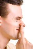 Männer hat einen Finger in der Wekzeugspritze gestoßen Stockbild