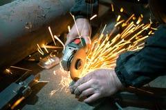 Männer ` s Handschnittmetall stockfoto