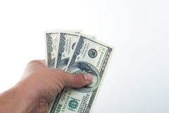 Männer sagten 10000 Dollar in der Hand Lizenzfreie Stockfotos