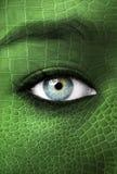 Människa med lizzardhudtextur - mutationbegrepp Royaltyfria Bilder
