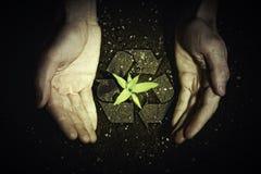 Människahänder och ekologisymboler Fotografering för Bildbyråer