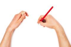 Människan räcker med ritar och raderar rubber handstil något Arkivbild