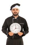 Männliche haltene Uhr des Chefs Stockfoto