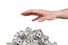 Männliche Hand, die Dollar-Banknoten erreicht Lizenzfreie Stockfotos