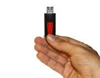 Männliche Hand, die USB-Antrieb hält Lizenzfreie Stockfotografie