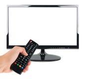 Männliche Hand halten Fernsteuerungs zum Fernsehschirm lokalisiert auf Weiß Lizenzfreies Stockfoto