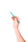 Männliche Hand mit einem Bleistiftschreiben etwas Stockbild