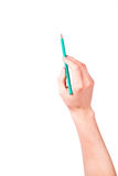 Männliche Hand mit einem Bleistiftschreiben etwas Lizenzfreie Stockbilder