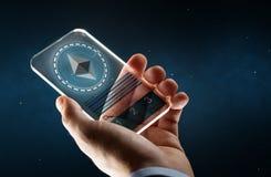 Männliche Hand mit ethereum auf Smartphoneschirm Stockbild