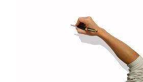 Männliche Hand mit Feder auf weißem Hintergrund Lizenzfreie Stockfotografie