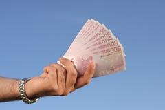 Männliche Hand voll der Eurobanknoten Lizenzfreie Stockfotos
