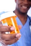 Männliche Krankenschwester und Pillen Lizenzfreie Stockbilder
