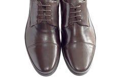 Männliche Schuhe auf Weiß Stockfotografie