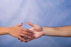 Männliche und weibliche Hände Stockbilder