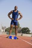 Männlicher Athlet At Starting Block Lizenzfreies Stockfoto