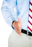 Männlicher Doktor, der seine Hand für einen Händedruck gibt lizenzfreies stockbild