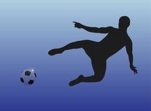 Männlicher Fußballspieler vor Ziel Stockfotografie