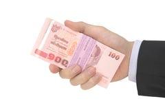 Männlicher Handholdingsatz Anmerkungen des thailändischen Baht Lizenzfreie Stockfotos
