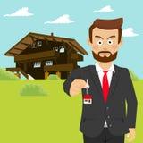 Männlicher Immobilienmaklergrundstücksmakler, der Hausschlüssel vor Haus zeigt lizenzfreie abbildung