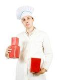 Männlicher Koch mit Paketen Stockbilder