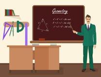 Männlicher Lehrer der Schulgeometrie im Publikumsklassenkonzept Auch im corel abgehobenen Betrag Lizenzfreie Stockfotos